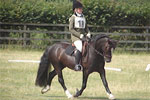 Georgina and Alfie doing dressage 2006